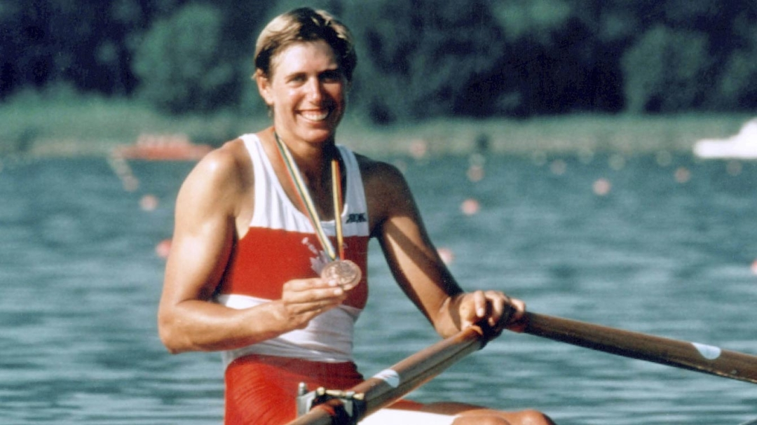 Laumann posing with her medal