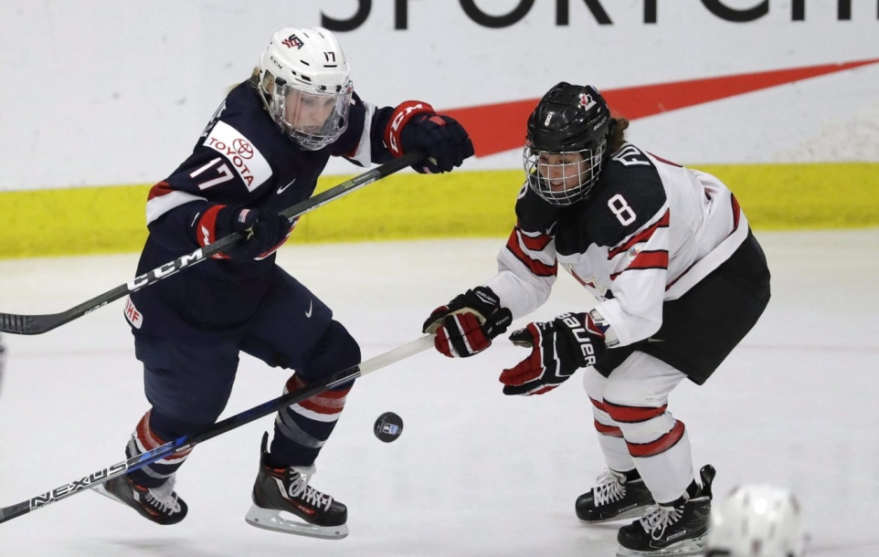 U.S. forward Jocelyne Lamoureux-Davidson (17) and Canada defender Laura Fortino (8) chase the puck