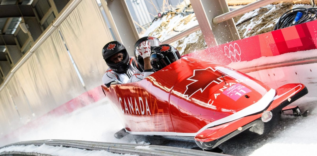 Bobsleigh racing down track