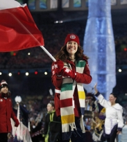 Hughes carrying Canadian flag in Opening Ceremony