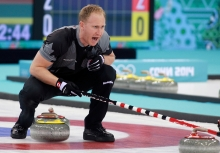 Brad Jacobs of Canada yells to his sweepers playing against Great Britain in the men's gold medal curling final at the Sochi Winter Olympics in Sochi, Russia, Firday, Feb. 21, 2014. THE CANADIAN PRESS/HO, COC - Mike Ridewood