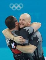 Two Team Canada teammates hugging