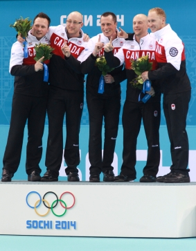 Men's Canadian curling team on the podium