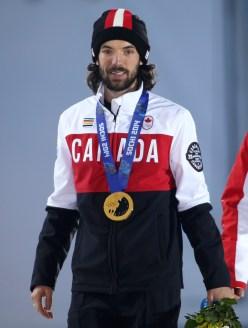 Charles Hamelin receives his gold medal in men's 1500 metre short track