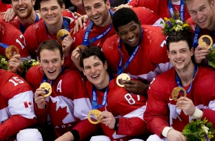 Team Canada captain Sidney Crosby celebrates with other Canada players after defeating Team Sweden to win the gold medal in Olympic final action at the Sochi 2014 Olympic Winter Games Sunday February 23, 2014 in Sochi, Russia. THE CANADIAN PRESS/Paul Chiasson