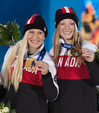 Kaillie Humphries and Heather Moyse receive the gold medal in women's bobsleigh at the Sochi 2014 Olympic Winter Games in Sochi, Russia, Thursday, Feb. 20, 2014. THE CANADIAN PRESS/HO, COC - Winston Chow
