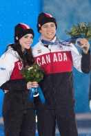 Tessa and Scott pose with their medals