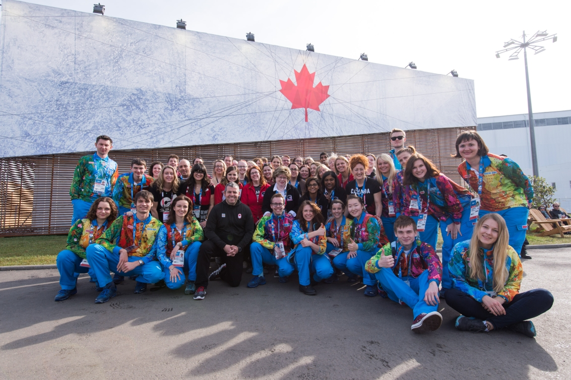 Volunteers in front of Canada Olympic House at Sochi 2014