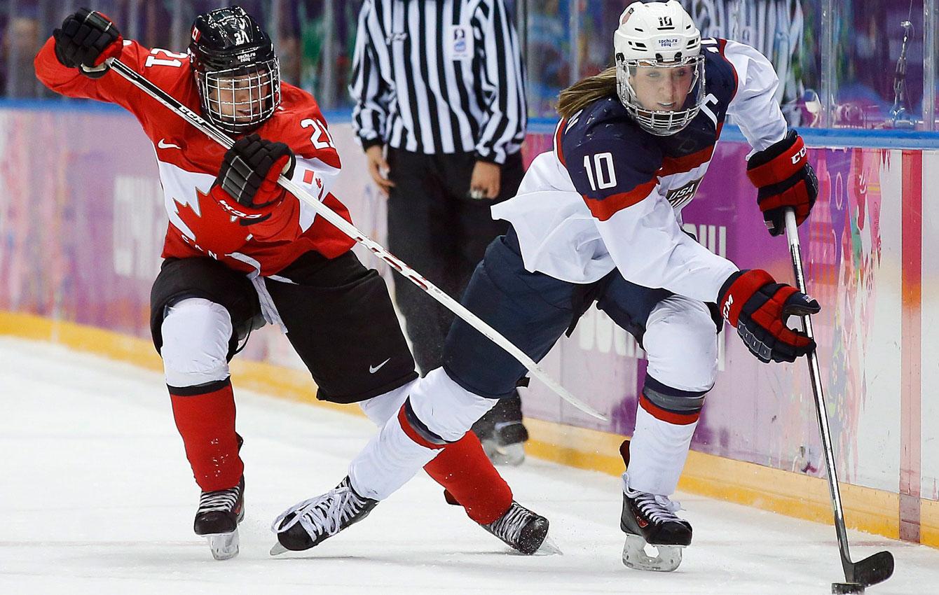 Canada's Haley Irwin battles with Meghan Duggan during the women's gold medal ice hockey game at Sochi 2014 (AP Photo/Matt Slocum)