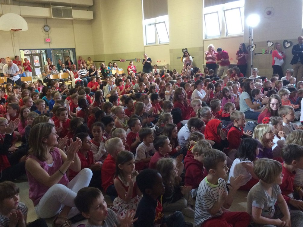 Students gather at King Edward Public School in Kitchener, Ontario, for the medal presentation. Schoolteacher Chris Rhoda used Junio's example of kindness to rally the students.
