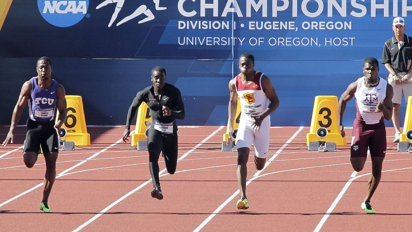 Aaron Brown (second from right) at the NCAA Track and Field Championships in 2013) via The Canadian Press.