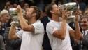 Jack Sock (left) & Canada's Vasek Pospisil win the 2014 Wimbledon men's doubles title. Photo via Tennis Canada. Photo: CP
