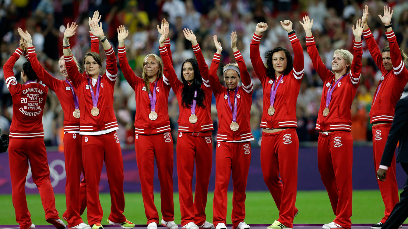 Canadian players receive their bronze medals at London 2012.