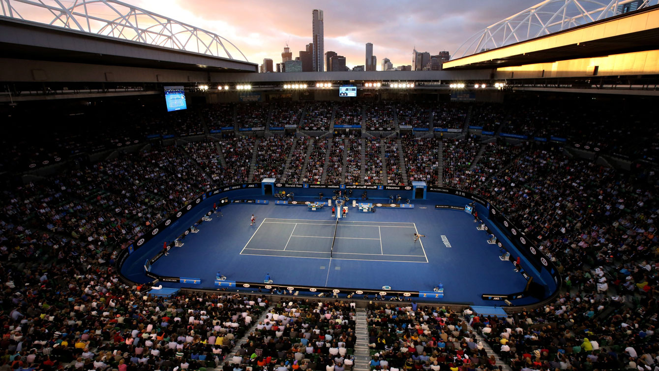 The Rod Laver Arena in Melbourne, Australia with the city's skyline in the background.