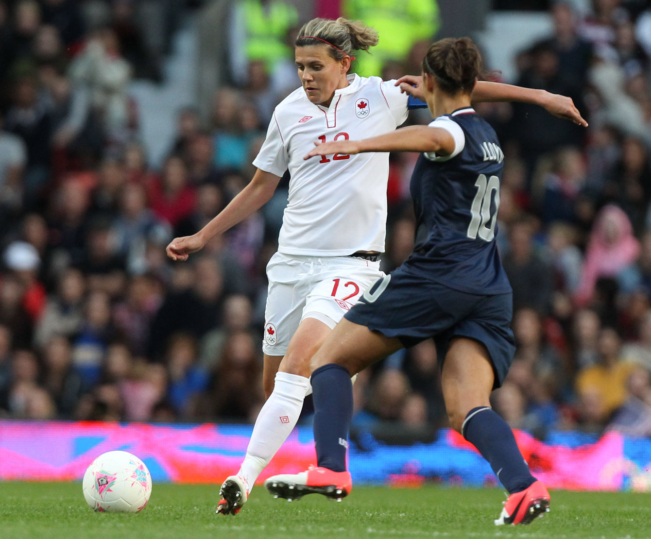Christine Sinclair (left) at London 2012 against the United States in the semifinals.