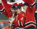 Patrice Bergeron, left, Sidney Crosby, centre, and Corey Perry celebrate their 2005 World Junior Championship gold medal (Photo: CP)