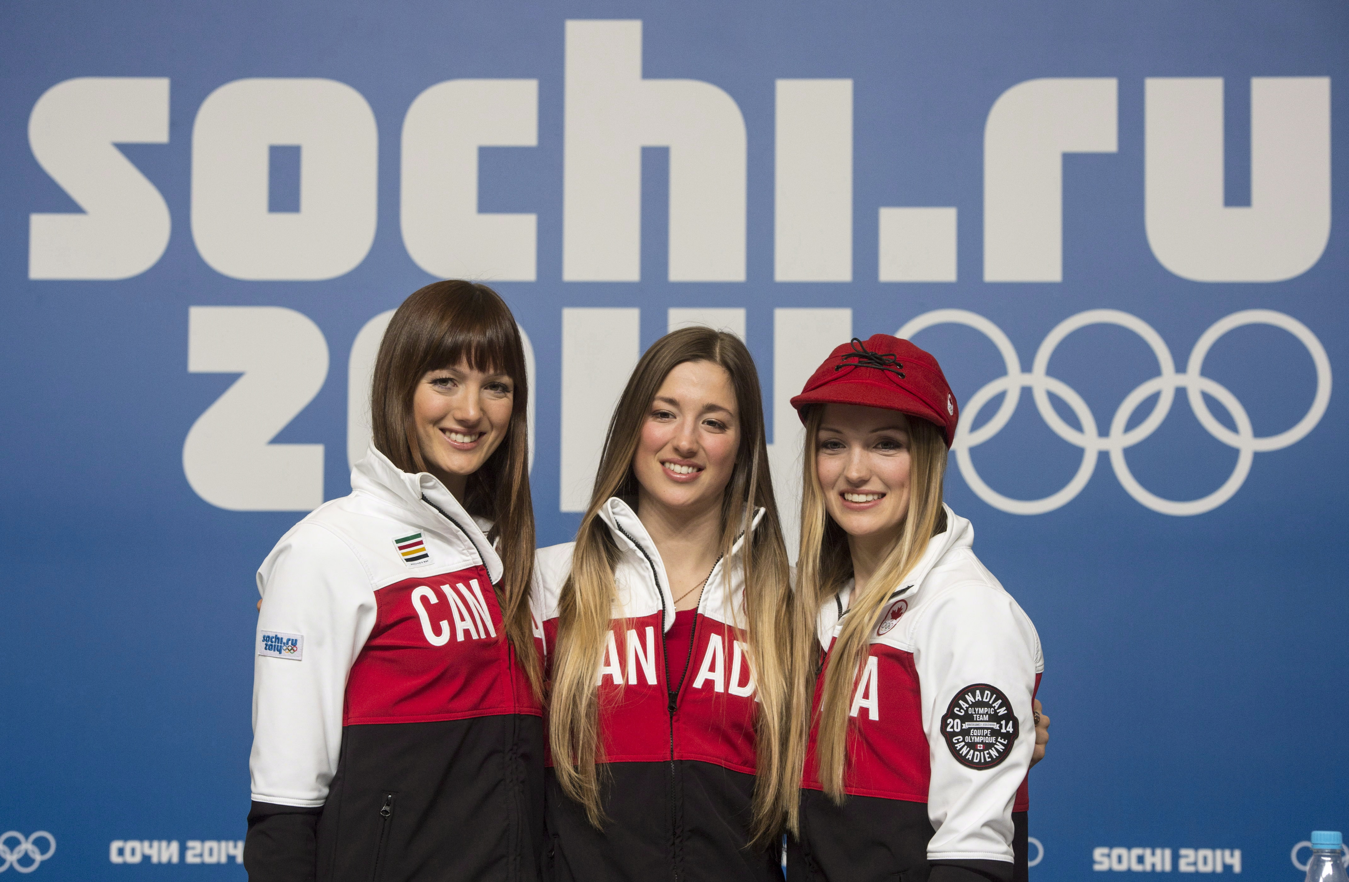 Sisters posing in front of Sochi 2014 Olympic Games sign