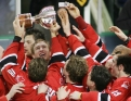 Team Canada celebrates with the trophy after defeating Russia in the 2005 World Juniors gold medal game (Photo: CP)