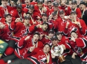 The team poses with the trophy after winning gold at the 2005 World Juniors (Photo: CP)