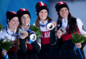 (From left to right) Marianne St-Gelais, Valérie Maltais, Jessica Hewitt and Marie-Ève Drolet receive their Sochi 2014 silver medal for the 3000m relay. (Photo: CP)