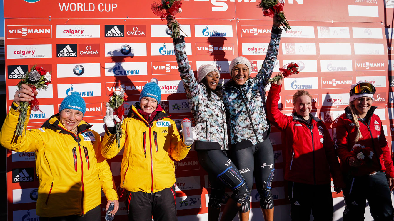 O'Brien stands next to Humphries (right side of podium) after her first World Cup bronze medal in bobsleigh.