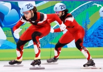 One short track speed skater pushed another in a relay
