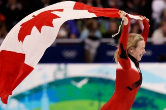 Canada's Marianne St-Gelais reacts after winning the silver medal in the women's 500m short track skating competition at the Vancouver 2010 Olympic Winter Games in Vancouver, British Columbia, Wednesday, Feb. 17, 2010. (AP Photo/Mark Baker)