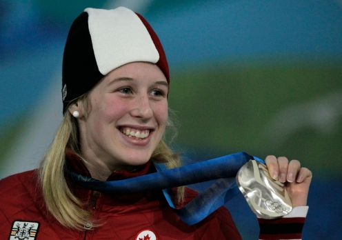 Canada's silver medalist Marianne St-Gelais reacts during the women's 500m short track medal ceremony at the Vancouver 2010 Olympic Winter Games in Vancouver, British Columbia, Thursday, Feb. 18, 2010. (AP Photo/Jae C. Hong)