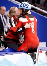 Canada's Charles Hamelin kisses Marianne St-Gelais after winning the gold medal in the men's 500 meter final in the short track speedskating competition Friday February 26, 2010 at the Vancouver 2010 Olympic Winter Games in Vancouver. THE CANADIAN PRESS/Paul Chiasson