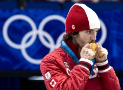 Canada's gold medalist Charles Hamelin kisses his medal after winning the men's 500 metre final in the short track speed skating competition Friday February 26, 2010 at the Vancouver 2010 Olympic Winter Games in Vancouver. THE CANADIAN PRESS/Paul Chiasson