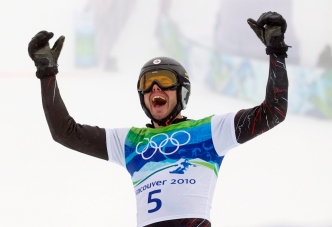 Jasey-Jay Anderson of Canada celebrates his gold medal run at the men's parallel giant slalom at Cypress Mountain in West Vancouver, B.C., Saturday February 27, 2010, at the 2010 Vancouver Olympic Winter Games. THE CANADIAN PRESS/Sean Kilpatrick