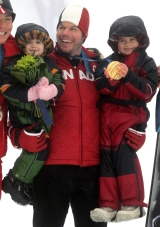 Canada's Jasey-Jay Anderson holds his daughters Jy, left, and Jora, right, as she holds his gold medal after he won the men's parallel giant slalom snowboard final at the Vancouver Winter Olympics at Cypress Mountain in West Vancouver, B.C., on Saturday February 27, 2010. THE CANADIAN PRESS/Darryl Dyck