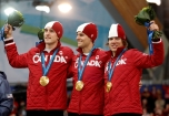 Team Canada's Denny Morrison, left, Lucas Makowsky, center, and Mathieu Giroux, right, are seen on the podium after winning the gold medal in the men's team pursuit final speed skating race at the Richmond Olympic Oval at the Vancouver 2010 Olympic Winter Games in Vancouver, British Columbia, Saturday, Feb. 27, 2010. (AP Photo/Matt Dunham)