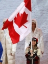 Women's figure skating bronze medallist Joannie Rochette carries the Canadian flag into the Vancouver 2010 Olympic Winter Games closing ceremony on Sunday, Feb. 28, 2010 at B.C. Place in Vancouver. THE CANADIAN PRESS/Nathan Denette