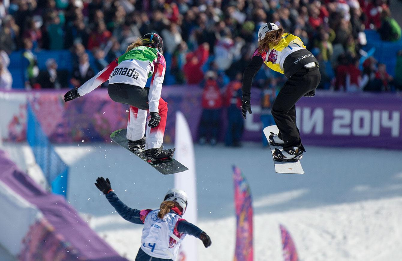 Snowboard cross racers near the finish line