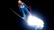 Ski jumper at night