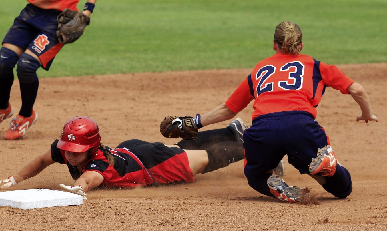 Joey Lye slides head first into second base