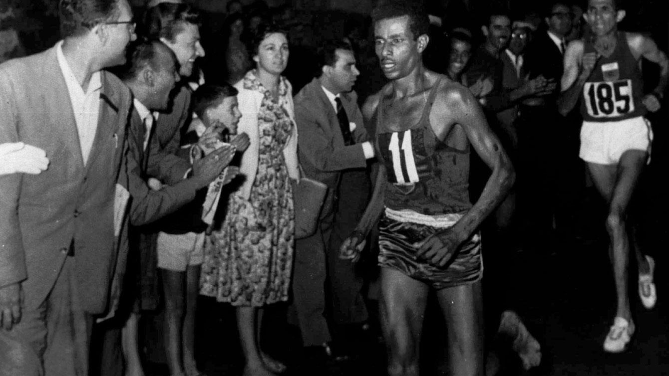 Abebe Bikila run the Olympic marathon barefoot through the streets of Rome.