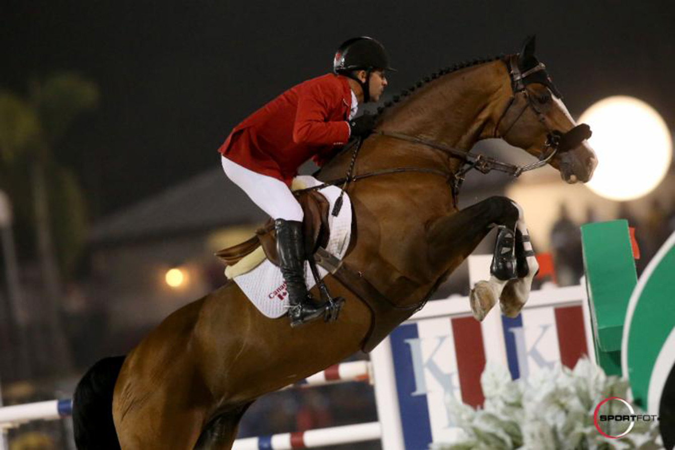 2008 Olympic champion Eric Lamaze rides Coco Bongo at the $100,000 Nations' Cup in Wellington, FL. Feb 27, 2015