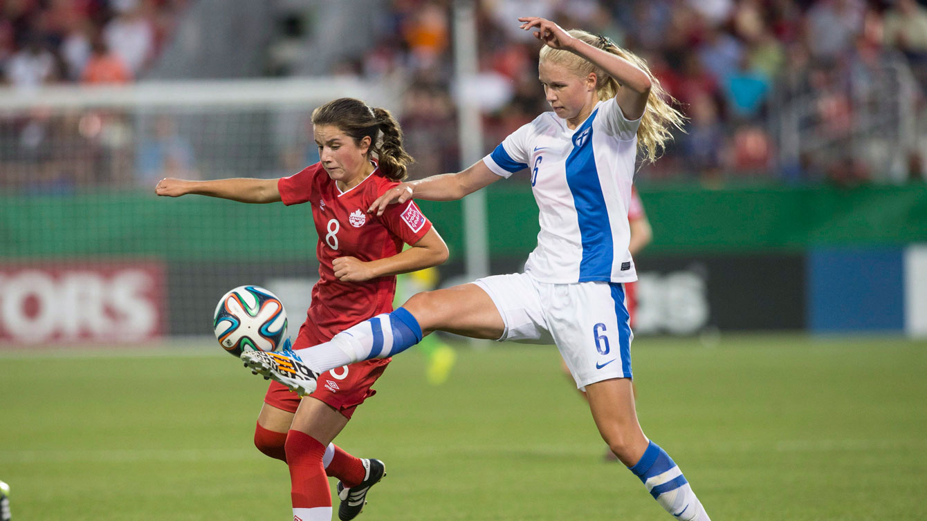 Jessie Fleming (left) in action at the 2014 FIFA Under-20 Women's World Cup in Canada.
