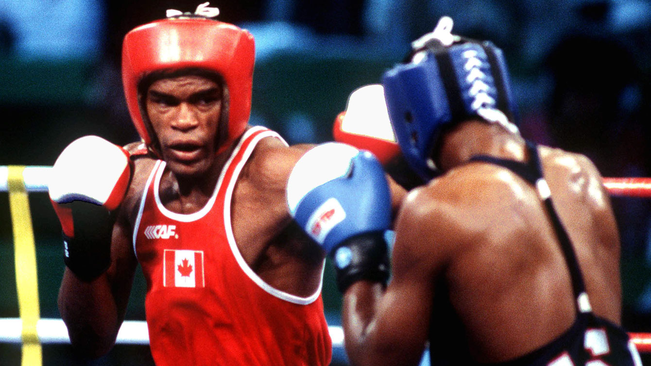 Chris Johnson in the ring against American Chris Byrd at the semifinals in Barcelona.