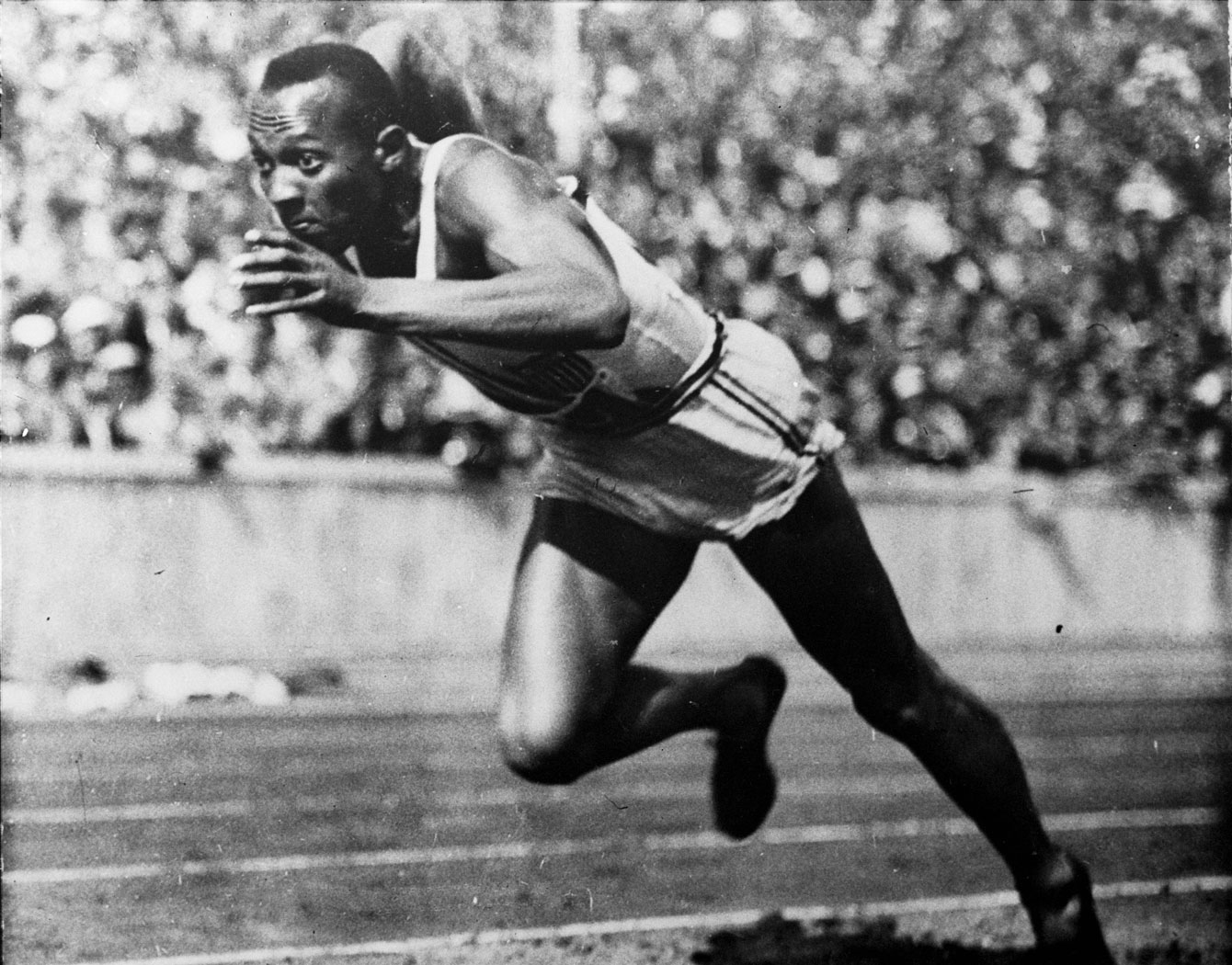 Jesse Owens takes off in a 200m preliminary at Berlin 1936.