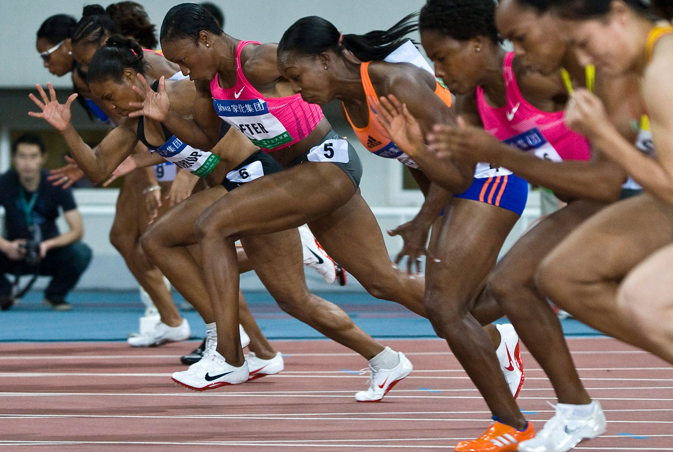 Carmelita Jeter (5) powers her way to the women's 100-metre title in Shanghai.