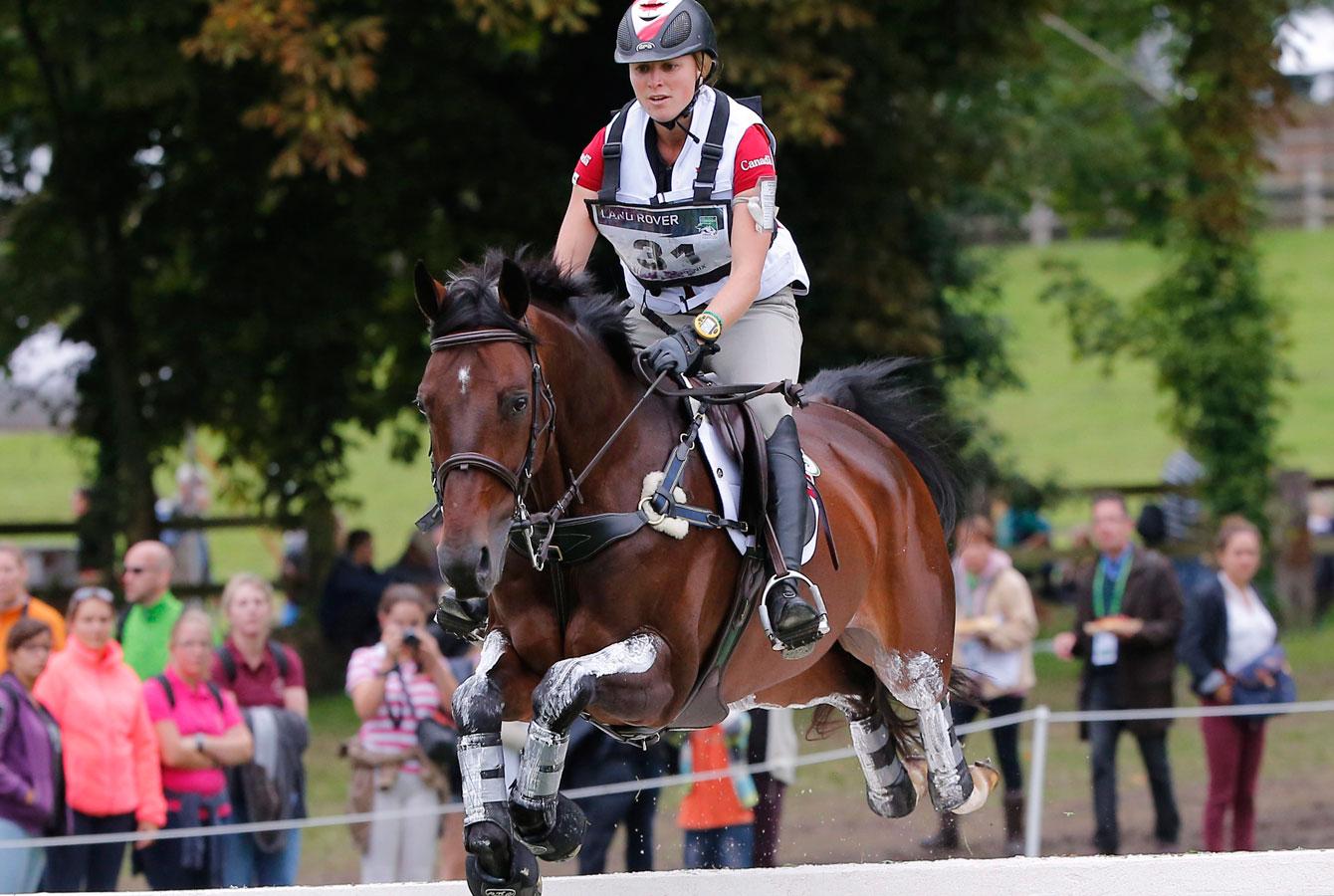 Jessica Phoenix riding Pavarotti at 2014 World Equestrian Games in France.