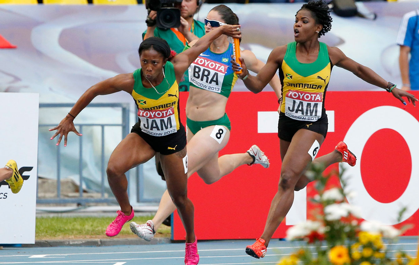 Shelly-Ann Fraser-Pryce takes the baton for the final leg of the women's 4x100m relay at Moscow 2013.