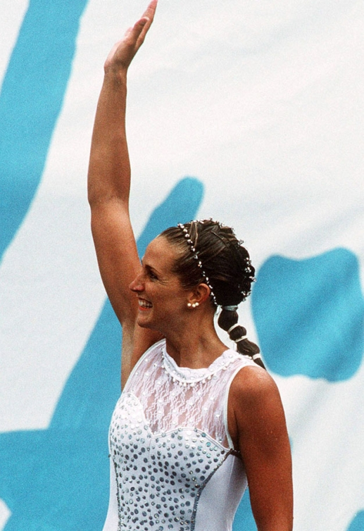 Sylvie Fréchette celebrates her silver finish, later awarded gold after a judging error at the Barcelona 1992 Olympic games