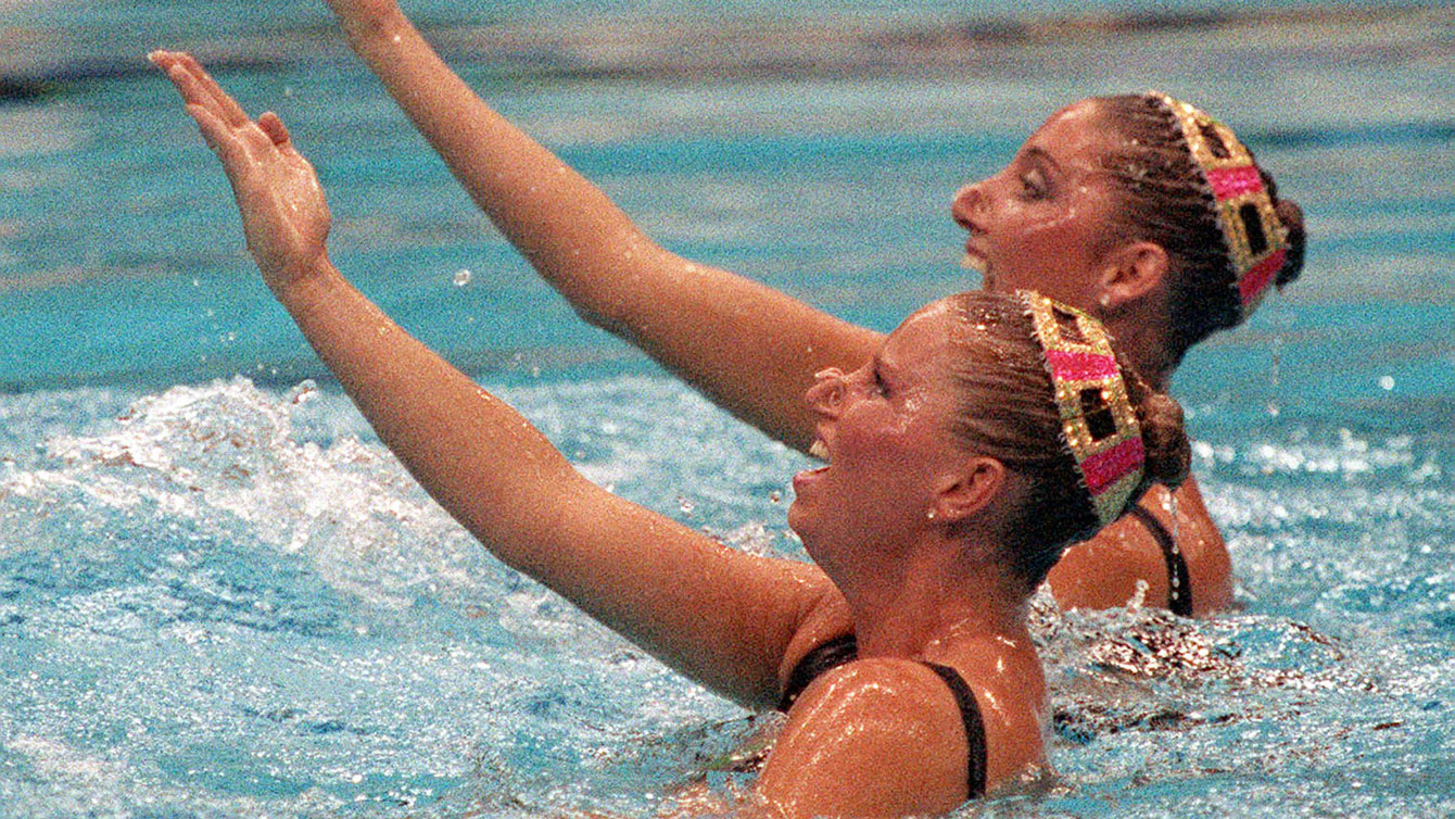 Canada's Carolyn Waldo (front) and Michelle Cameron swim for Olympic gold in the synchronized swimming duet event at the 1988 Olympic games in Seoul. (CP PHOTO/ COC/ Ted Grant)