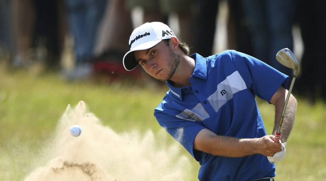 Canada's Austin Connelly chips out of the bunker