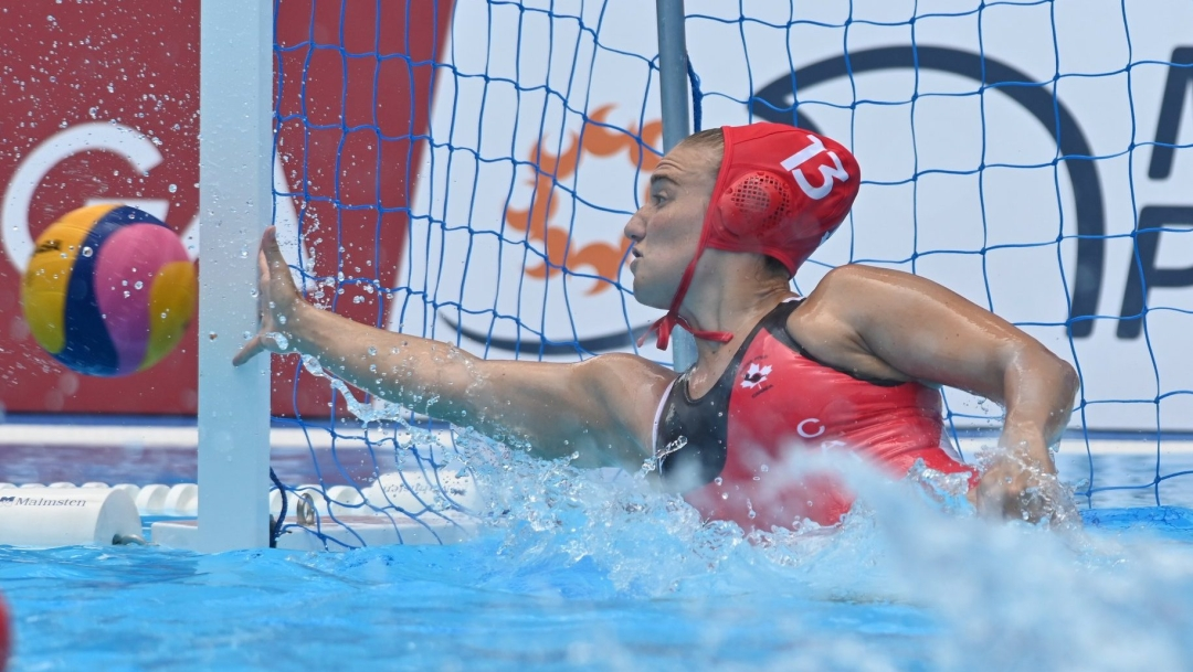 Water polo goalkeeper makes a save