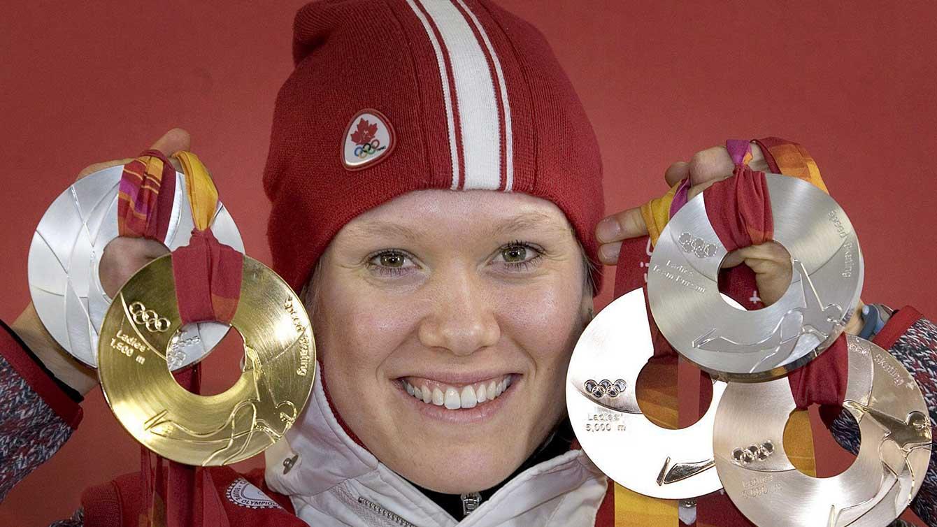 Klassen holding up all 5 medals